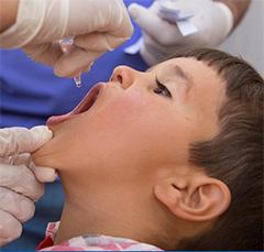A child is immunized against polio.
