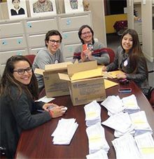 Rotary Exchange Students help Rotary members in Minnesota pack school materials for a nonprofit in Guatemala.