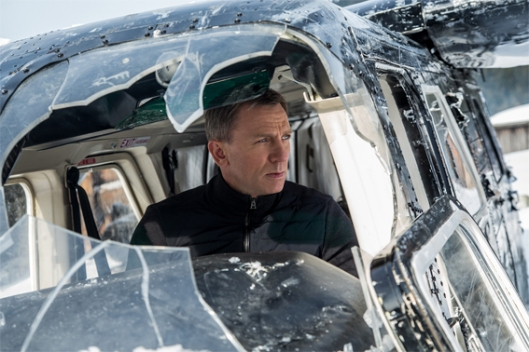 photo of Daniel Craig as James Bond, in the cockpit of a crashed helicopter